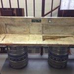 Скамейка из двух досок (сиденье и спинка) и пивных кег (ножки)