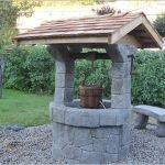 колодец из камня в саду