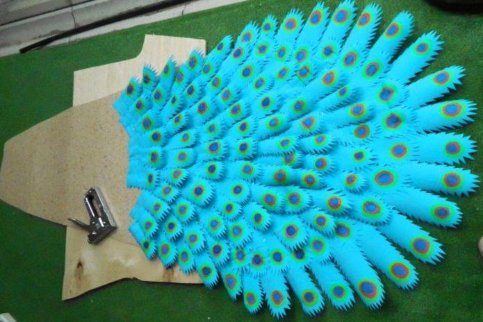 Крепление перьев степлером